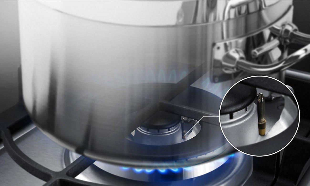 Bezpieczne gotowanie, dzięki zabezpieczeniu przeciwwypływowemu w płycie gazowej Samsung NA64H3010AS